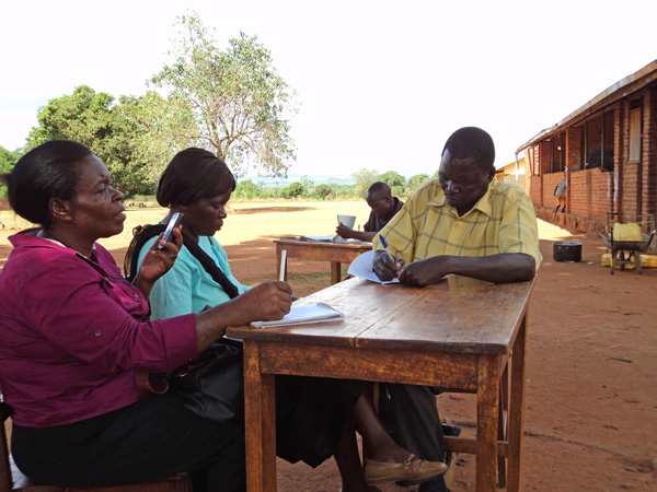 Teachers in rural northern Uganda used mobile phones to complete follow-up surveys about the impact of WASH education. Credit: © Project WET Foundation