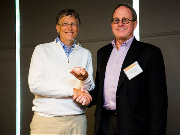 Bill Gates presenting the first prize award to California Institute of Technology at the Reinvent the Toilet Fair in Seattle on August 14, 2012. Photo Credit: ©Bill & Melinda Gates Foundation / Michael Hanson
