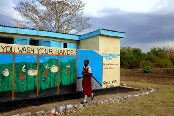 Latrines, like the one pictured here, and improved school WASH conditions help reduce girls' absenteeism — just one important finding from SWASH+ research. Credit: CARE / Brendan Bannon, Kenya, 2012