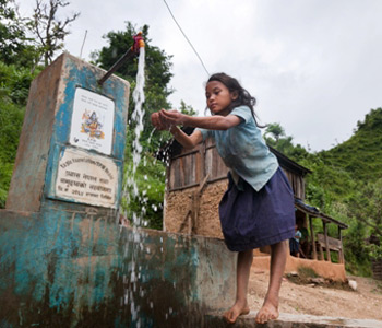School girl from Jogimara, Nepal, washing her hands at a Restless Development Nepal water supply. (2011 Asia-Pacific Health Award Winner) Credit: Kristian Buus