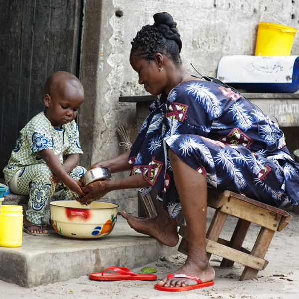 A mother washing her child's hands in Benin. Credit: Ollivier Girard
