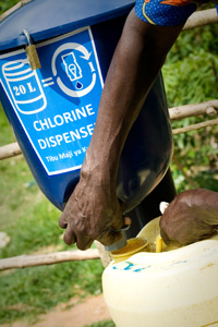 Dispenser's valve releases metered dose of chlorine into jerricans. Credit: Dispensers for Safe Water