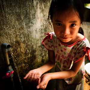 A 5-year-old girl in Da Nang, Vietnam benefits from an East Meets West Foundation project, which is tracked and managed on Blue Planet Network's platform. Credit: Christine Krieg