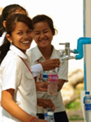 Soramarith Secondary School students drinking clean water from a new water system at their school. Credit: Christine Krieg