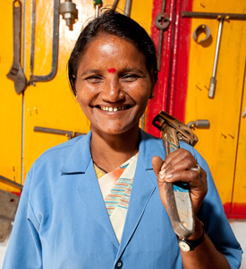 Handpump mechanic, Ram Rati, with the tools that she uses to repair waterpoints in Mahoba district, India. Credit: Esther Havens for The Adventure Project