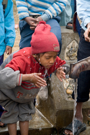A boy in Nepal washes his face, a hygiene activity that can help prevent against infection with the blinding disease trachoma. Credit: International Trachoma Initiative