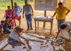 A hygiene promotion exercise in La Guajira, Colombia conducted together with beneficiaries meant to create awareness regarding waste disposal practices. Credit: Francesca Moschini (Aguayuda)