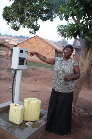 Farahilh Masane collecting water from a prepaid meter in Kawempe, Kampala. Credit: WaterAid / Libby Plumb