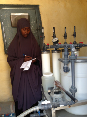 Leyla Hassan, Arc Solutions Program Excellence Officer, collects information at a project site in Mogadishu. Credit: Arc Solutions