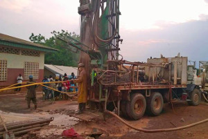 July 24th, 2014, Water for Good team drilled a 278 ft deep borehole at St. John of Galabadja parish in Bangui, CAR, where thousands of displaced people are seeking protection. Credit: Water for Good