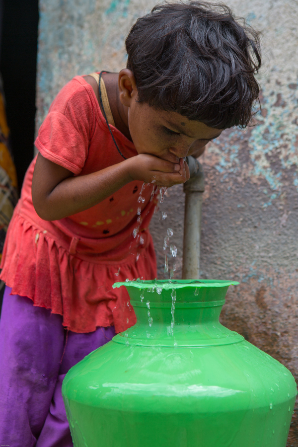 Getting a safe drink of water in Bangalore, India. Photo Credit: Water.org