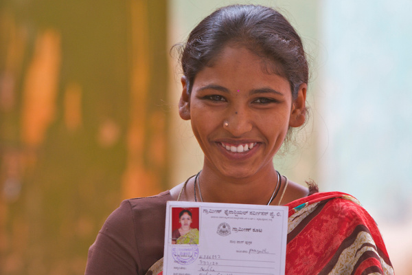 A woman shows her WaterCredit loan card in Bangalore, India. With a WaterCredit loan she is able to pay for water improvements to her home. Photo Credit: Water.org