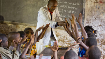 A school teacher leads a community-led total sanitation activity in Ethiopia.