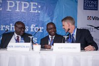 Charles Nimako, Country Director, and Kurt Soderlund, CEO, Safe Water Network, talk with Hon. Sampson Ahi (MP), Deputy Minister for the Ministry of Water Resources, at the opening session.
