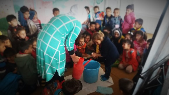 ACTED case workers conducting hygiene education activities with children in Syrian refugee camp - ACTED Iraq, 2016
