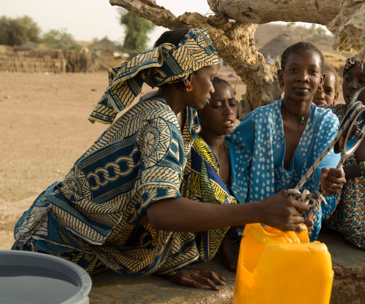 Women retrieve water from a well in Senegal. Photo Credit: Ariadne Van Zandbergen/Alamy Stock Photo